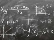 Blackboard photo with formulas written on it, for the Professional Education in Commercial Real Estate blog post